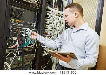 Networking service. network engineer administrator checking server hardware equipment of data center poster