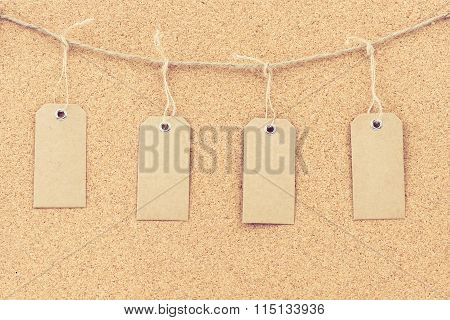 Vintage Grunge Empty Tags Hanging On Rope String