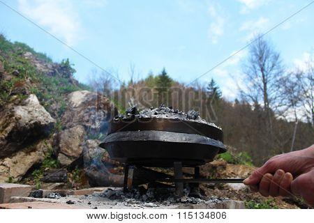 Preparing and Cooking of octopus in traditional Balkan Bosnian Mediterranean meal Peka in metal pots