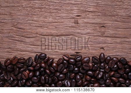 Roasted Coffee Beans On Wood Background.