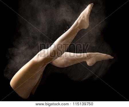 Woman Legs Scissor Kick With White Powder