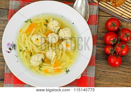 Soup with chicken meatballs and noodles
