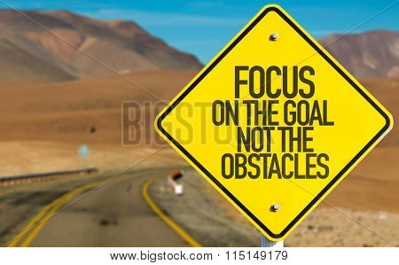 Focus On The Goal Not The Obstacles sign on desert road