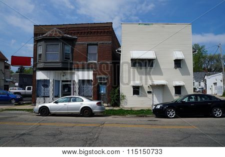 Shuttered Storefront and a Residential Building