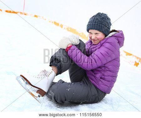 Teen Skater Girl Fall Down On Ice Rink