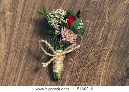 Wedding Boutonniere On Wooden Background In Rustic Style