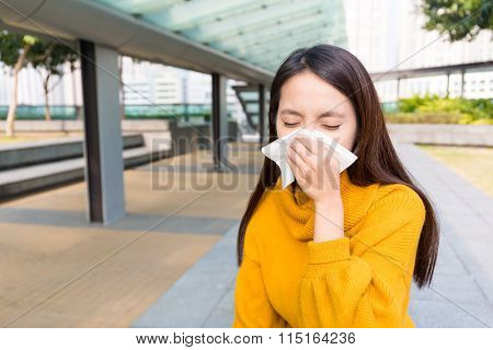 Asian woman runny nose