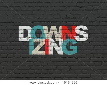 Business concept: Downsizing on wall background
