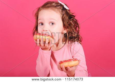 Kid girl eating cakes