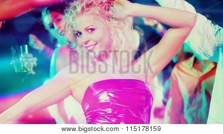 Girl dancing in disco club celebrating with friends, filtered image