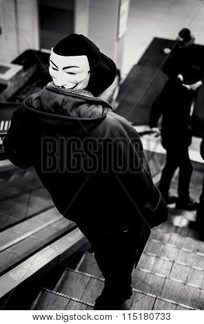 Hooded Youth Wearing A Vendetta Mask