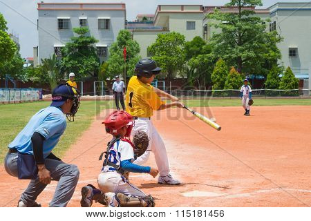 Zhongshan Panda Cup, Zhongshan, Guangdong - August 3:unknown Batter Hitting The Ball During A Match