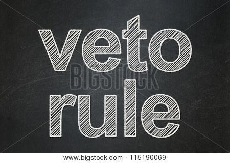 Politics concept: Veto Rule on chalkboard background