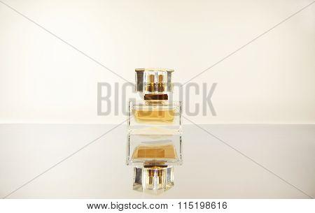 Women's Perfume On Mirror Surface