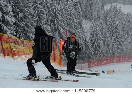 KITZBUHEL, AUSTRIA - JANUARY 25 2014:   Coaches on Hahnenkamm Course during the Audi FIS Alpine Ski World Cup Downhill race in Kitzbuhel, Austria.