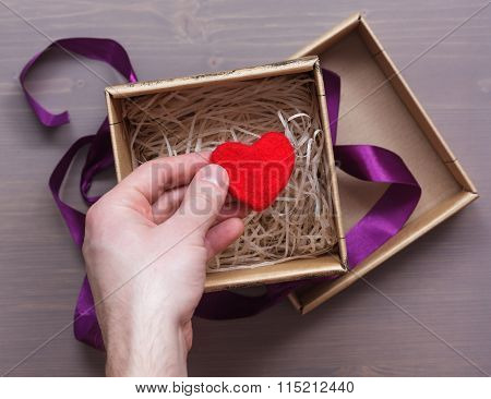 Man Packs A Gift For Valentine's Day