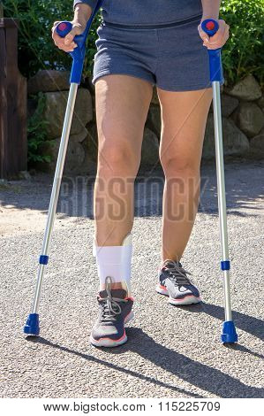 Person With Ankle Brace Walking With Crutches