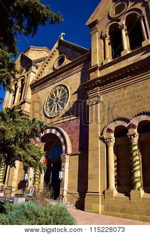 January 14, 2016 in Santa Fe, NM:  Cathedral Basilica of St Francis of Assisi opened in 1886 which is the main cathedral in Downtown Santa Fe and where locals and tourists can worship and admire the beautiful architecture taken in Santa Fe, NM