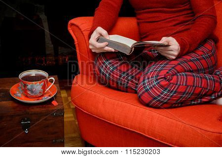 Lady Reading And Drinking Tea By The Fireplace