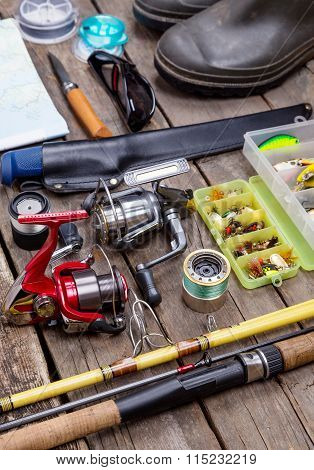 Fishing Tackles For Journey On Wooden Boards