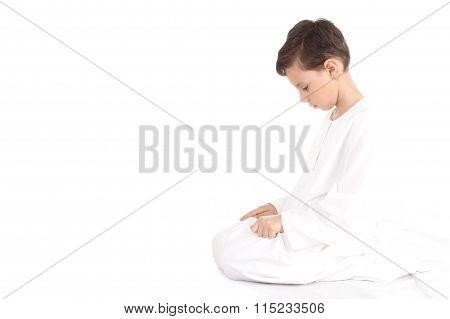 Muslim young boy praying