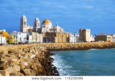CADIZ, SPAIN - DECEMBER 30: Panoramic view of the city on December 30, 2015 in Cadiz, Spain, bordered by the Mediterranean sea and its Cathedral, called Catedral Nueva by locals, in the background
