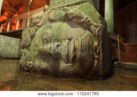 Medusa head in The Basilica Cistern, Istanbul, Turkey. poster