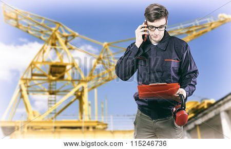 Worker In Protective Uniform And Ear Muffs
