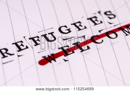 refugees welcome strikethrough text on white line paper