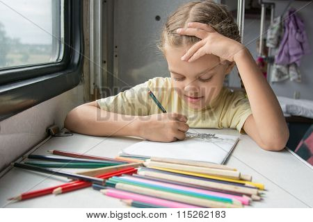 Six-year Girl Joyfully Draws Pencils In Second-class Train Carriage