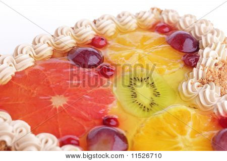 Cake with cream garnished with fruits in jelly