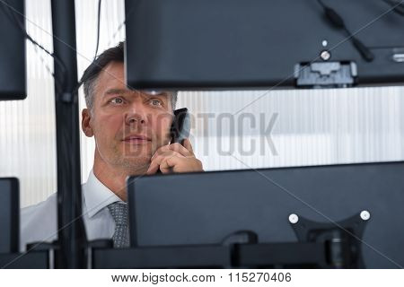 Stock Trader Looking At Multiple Computer Screens