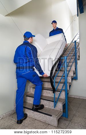Movers Carrying Sofa On Steps