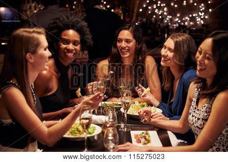 Group Of Female Friends Enjoying Meal In Restaurant
