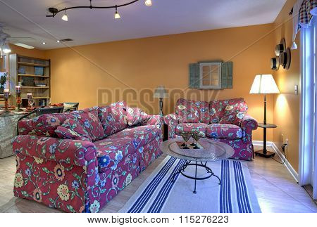 Decorated living and diningroom, open concept apartment with orange walls