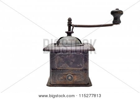 an old and rusty manual burr-mill coffee grinder on a white background
