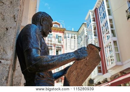 Burgos statue or the newspaper reader next to Plaza Mayor square in Castilla Spain