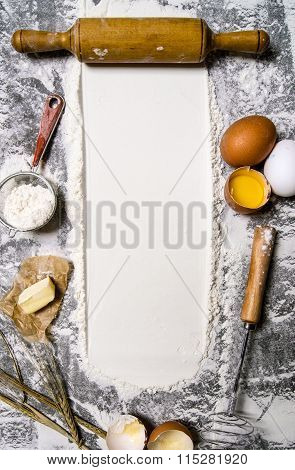 Preparation Of The Dough. The Rolling Pin With Flour And Other Ingredients For The Dough On The Ston
