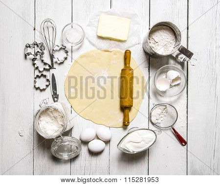 Preparation Of The Dough. The Rolled Out Dough With The Ingredients - Flour, Eggs, Sour Cream And Co