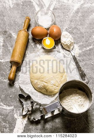 The Dough And The Ingredients - Eggs, Flour And Tools - A Rolling Pin And Shape.