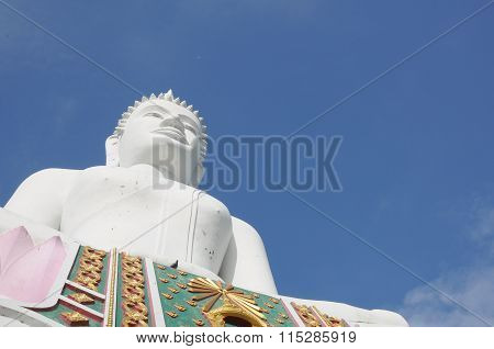 White buddha against the sky