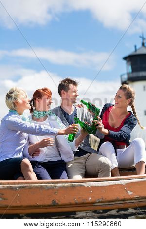 Friends drinking bottled beer enjoying vacation at German north sea beach