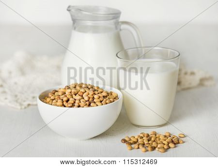 Soy milk  and soybeans on a white table