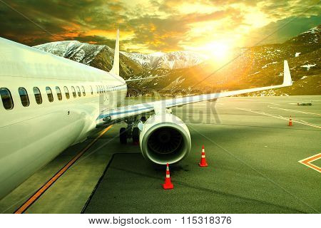 Pasenger Plane Parking On Airport Runnway Against Beautiful Sun Rising Sky Use For Traveling Buisine