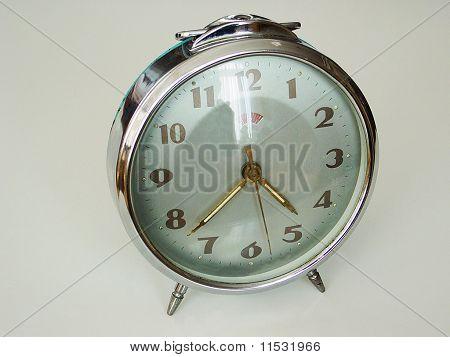an old windup alarm clock