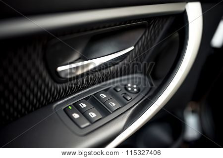 Car Interior Details Of Door Handle With Windows Controls And Adjustments. Car Window Controls And D