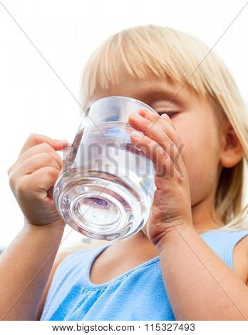 Little girl drinking water on white background