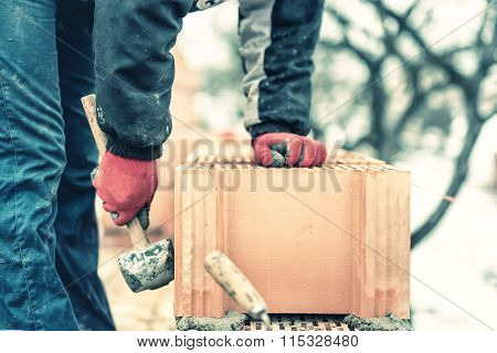 Detail Of Worker, Bricklayer Construction Engineer Fixing Bricks And Building Walls At New House