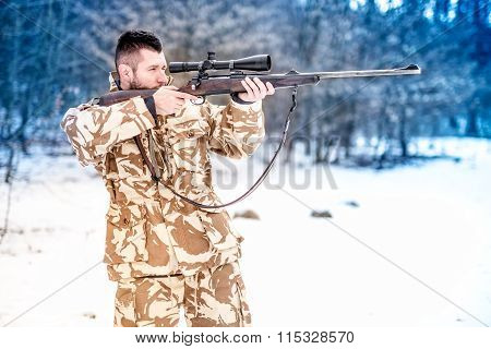 Military Man Holding A Sniper Rifle And Aiming At Enemy On The Battlefield