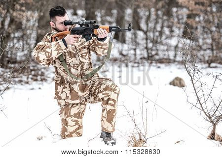 Military Army Man Firing Machine Gun On Battlefield